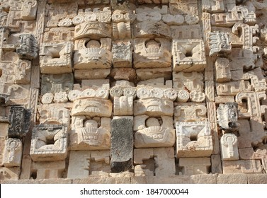 Ancient wall with carved ornament with god Chaac masks (god of rain), Mayan royal complex, Uxmal, Yucatan, Mexico. UNESCO world heritage site