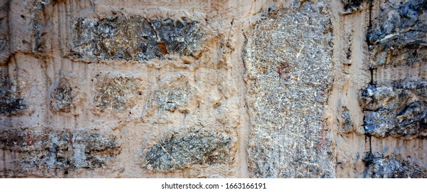 Ancient wall folded of rough stones in Montenegro