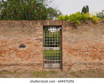 Ancient wall, gate, secret garden
