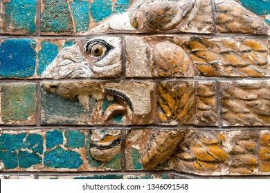 Ancient wall relief of a lion close-up. Detail of Babylonian Ishtar Gate. Remains of the culture of ancient Assyrian and Sumerian civilization. Art of Mesopotamia.