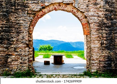 ancient walls rich in history, bricks and stones, arched doors and windows open glimpses of mountain landscapes, Forte Interrotto, Asiago, Vicenza, Veneto, Italy