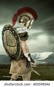 Ancient warrior or Gladiator posing with mountains in the background