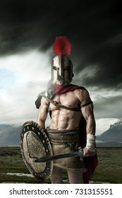 Ancient warrior or Gladiator posing outdoors with helmet