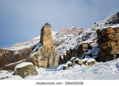 Ancient watchtower of Amirkhanovs on a rock in Upper Balkaria