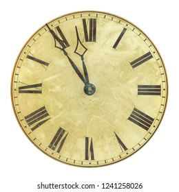 Ancient weathered clock face with the time five to twelve isolated on a white background