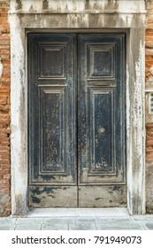 ancient weathered wooden door in Venice, Italy