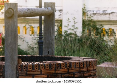 Ancient well or groundwater with wooden pole