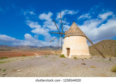 ancient wind mill on the hill of Genoveses Beach in Gata Cape in Nijar (Almeria, Andalusia, Spain, Europe). Built in the Nineteenth century