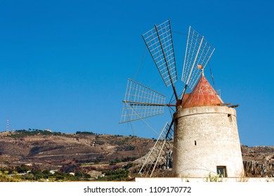 Ancient windmill on a background of blue sky
