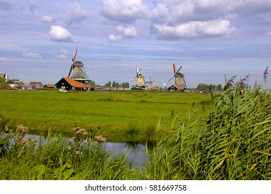 Ancient windmills in Zaanse Schans museum, near Westzaan, Netherlands.
