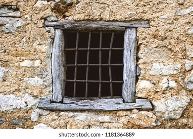 Ancient window attached to a historic stone house.