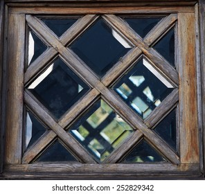 Ancient  window. Closeup of old wooden window frame.