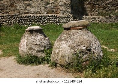 Ancient wine clay pots in the complex of Svetitskhoveli church, Georgia