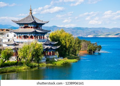 "The ancient wooden Buddhist Temple on the lakeside of Erhai lake in Dali town, Yunnan province, China. Translation is ""Buddha's Temple nea blue lake""."