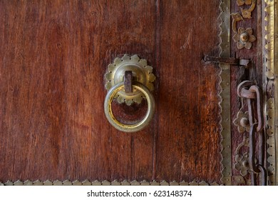 Ancient wooden door at the castle in Jaipur, India. Close up.