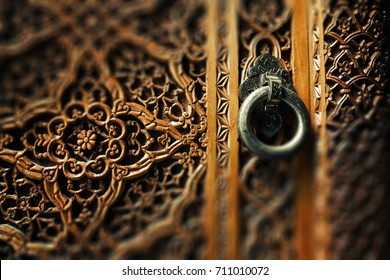 Ancient wooden door and metal ring handle