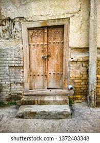 Ancient wooden door in old town of Bukhara, Uzbekistan