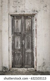 Ancient Wooden door and old white walls