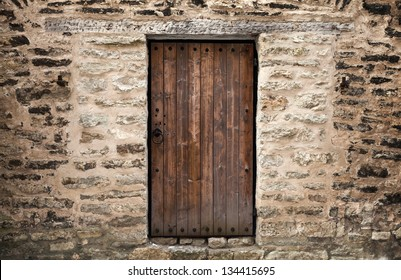 Ancient wooden door in stone castle wall. Tallinn, Estonia