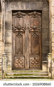 Ancient wooden entrance door to the Basilica of Saint Denis. Basilique Saint-Denis is a large medieval abbey church in the city of Saint-Denis. France