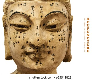 Ancient wooden female face showing acupuncture points, isolated on white background  (Translation: all the characters are no text, but individual names of each acupuncture point.)
