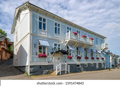 Ancient wooden house building in old part of Naantali town at sunny summer day. Naantali, Finland.