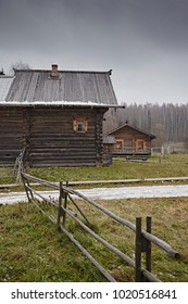 Ancient wooden houses in the countryside. Made by traditional carpentry technologies. Villages of Russia.