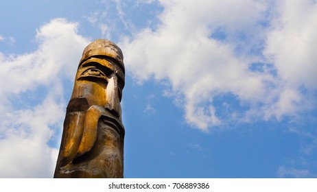 ancient wooden idol of the Slavic Scandinavian god against the sky