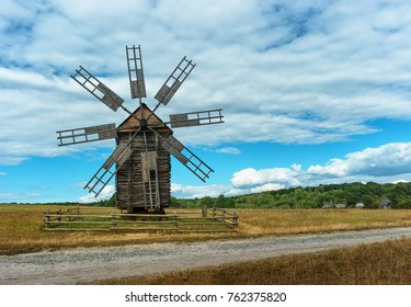 Ancient wooden mill in the autumn field. Ukraine, Kiev, Porogovo