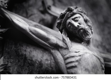 Ancient wooden statue of crucifixion of Jesus Christ as a symbol of resurrection and immortality of the human soul