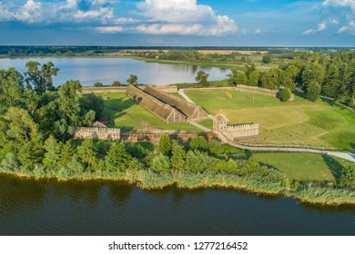 The ancient wooden stronghold. Biskupin museum on the lake, Poland. Aerial view from drone