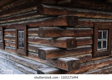 ancient wooden wall and window, of Cossack state guard army troop 16-18 centuries. Khortytsia island on broad Dnipro summertime, vintage houses construction technology background