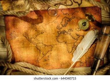 Ancient world map with a variety of accessories. Vintage still life. Travel concept.