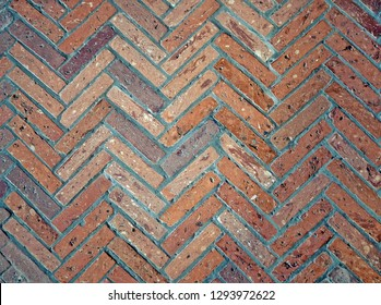 Ancient zigzag  brick floor pattern with different shades of red