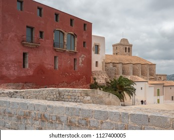 Ancient zone of the fortified city of Ibiza, Spain. Santa María Cathedral and tourists strolling around the place