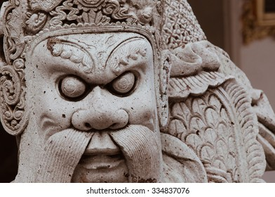 Ancint Chinese Stone Statue Is Outdoor Decoration of Wat Pho Temple at Bangkok, Thailand.