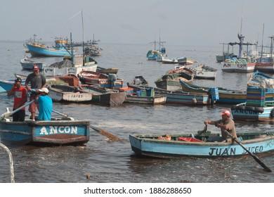 Ancon, Lima, Peru; 02 04 2017: Peruvian artisanal fishermen on the Ancon pier landing their catch