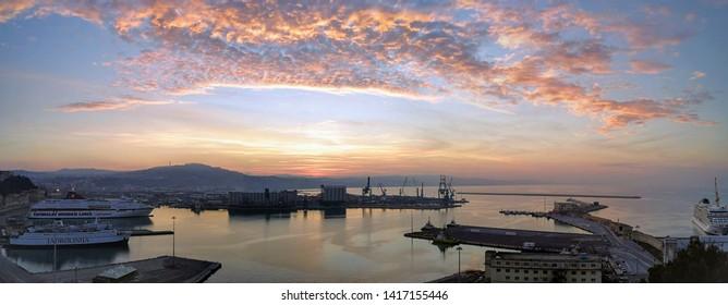 ANCONA, ANCONA/ITALY - DECEMBER 2018: Sunset over the port of Ancona seen from the San Ciriaco promontory.