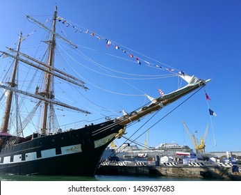 Ancona, Italy 10 june 2018: Bow of a sailboat moored in the port of Ancona for the Navy Day. the sails are folded. the sky is blue without clouds. Palinuro ship