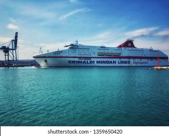 Ancona, Italy 4 april 2019: ship of the grimaldi minoan high speed lines entering the port of the city at sunset
