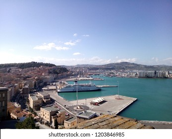 Ancona, Italy - April 2017. View from the top of the port of Ancona. Visible an anchored cruise boat. City in the background.