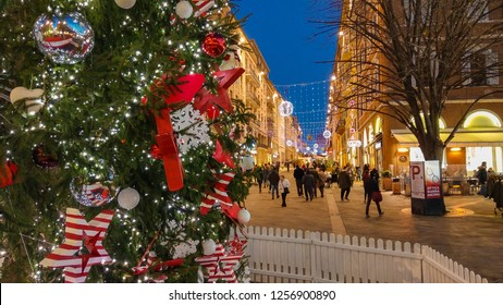ANCONA, ITALY - DECEMBER 12, 2018: Main street of Ancona with big christmas tree and christkindlmarkt, Marche, Italy