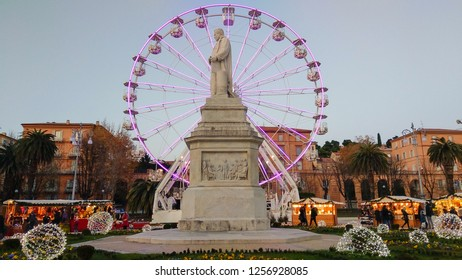 ANCONA, ITALY - DECEMBER 12, 2018: Big colores ferris wheel and christmas market in Piazza Cavour of Ancona city at sunset, March, Italy