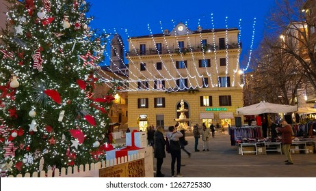 ANCONA, ITALY - DECEMBER 12, 2018: Piazza Pertini with big christmas tree and lights in the center of Ancona