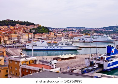 Ancona, Italy - June 8, 2019: The harbor of Ancona with cruise liner ships and boats docked and ancient city view. City port view.