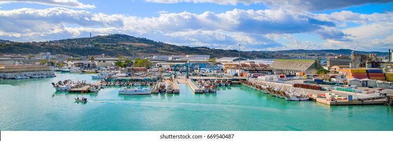 Ancona, Italy - November 18, 2014: The harbor of Ancona panorama with boats docked and city on the hill