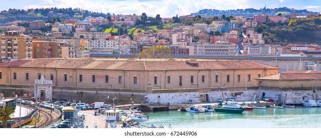 Ancona, Italy - November 18, 2014: The harbor of Ancona with the boats docked and city panorama