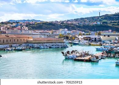 Ancona, Italy - November 18, 2014: The harbor of Ancona with the rows of the boats docked and city view