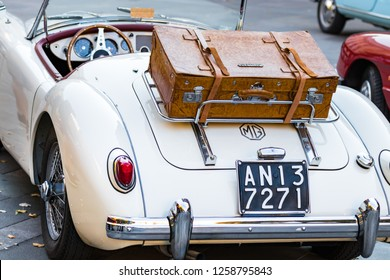 Ancona , Italy - September 23th, 2018 :  Rear view of a MG MGA 1960 - 61 vintage car with leather luggage at a vintage cars exhibition in Ancona, Italy.