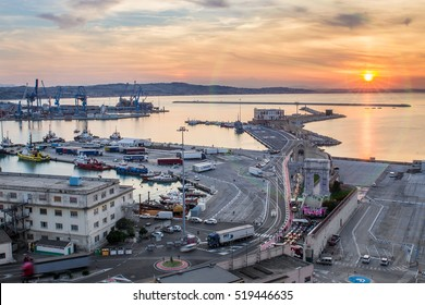ANCONA, ITALY - SEPTEMBER 3, 2016: Industrial commercial port at sunset, Ancona, Italy. View from the hill